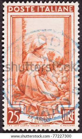 ITALY - CIRCA 1950: A stamp printed in Italy shows a farm woman sorting oranges, circa 1950.