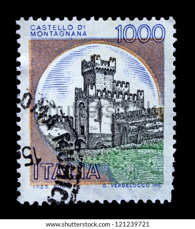 ITALY - CIRCA 1989: A stamp printed in Italy, shows a picture of Montagnana Castle, circa 1989 - stock photo