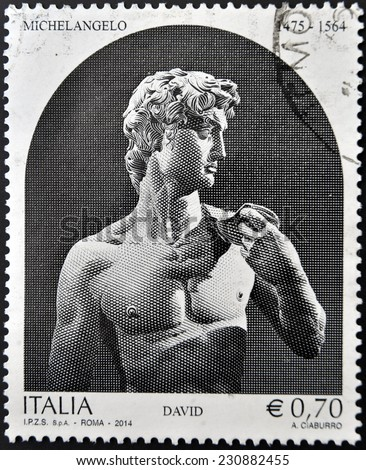 ITALY - CIRCA 2014: A stamp printed in Italy shows a statue of Michelangelo, David, circa 2014 - stock photo