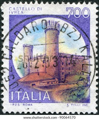 ITALY - CIRCA 1980: A stamp printed in Italy, shows Castle Ivrea, Turin, circa 1980 - stock photo