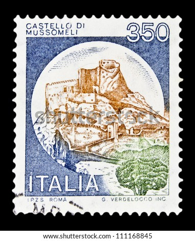 """ITALY - CIRCA 1980: A stamp printed in Italy, shows castle Mussomeli, Caltanissetta with the same inscription, from the series """"Italian castles"""", circa 1980 - stock photo"""