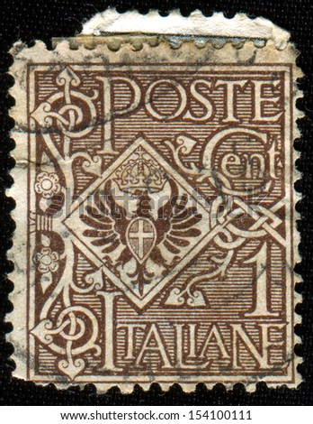 ITALY - CIRCA 1901:  A stamp printed in Italy shows Coat of arms, circa 1901  - stock photo