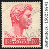 ITALY - CIRCA 1956: A stamp printed in Italy shows  Head of the statue of St. George, by Donatello, Florence, circa 1956 - stock photo