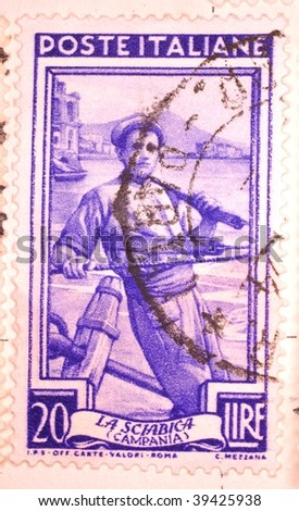 ITALY - CIRCA 1953: A stamp printed in Italy shows image of a fisherman on a beach, series, circa 1953