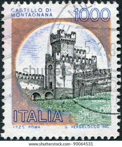 ITALY - CIRCA 1980: A stamp printed in Italy, shows the Castle of San Zeno, circa 1980 - stock photo