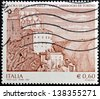 ITALY - CIRCA 2007 - A stamp printed in Italy shows the gothic abbey Sacra di San Michele, Sant'Ambrogio, near Turin, in Italy, circa 2007 - stock photo