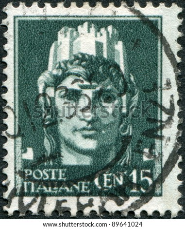 """ITALY - CIRCA 1929: A stamp printed in Italy, shows the symbol of """"Italia"""" (Woman with castle on her head), circa 1929 - stock photo"""