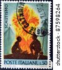 ITALY - CIRCA 1968: A stamp printed in Italy shows two boy scouts by the fire, circa 1968 - stock photo