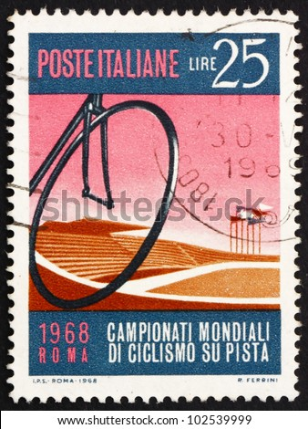 ITALY - CIRCA 1968: a stamp printed in the Italy shows Bicycle Wheel and Velodrome, Bicycling World Track Championships at the Velodrome in Rome, circa 1968 - stock photo