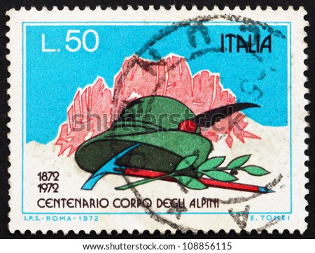 ITALY - CIRCA 1972: A stamp printed in the Italy shows Mountains, Alpinist's Hat, Pick and Laurel, Centenary of the Alpine Corps, circa 1972 - stock photo