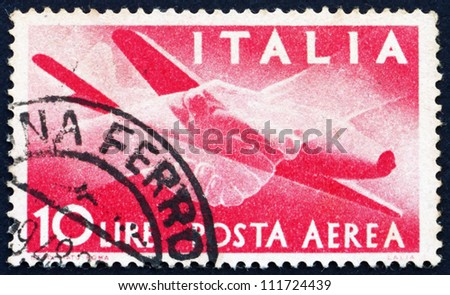 ITALY - CIRCA 1945: a stamp printed in the Italy shows Plane and Clasped Hands, circa 1945 - stock photo