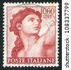 ITALY - CIRCA 1961: stamp printed by Italy, shows Designs from Sistine Chapel by Michelangelo, Eve, circa 1961 - stock