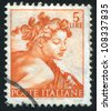 ITALY - CIRCA 1961: stamp printed by Italy, shows Designs from Sistine Chapel by Michelangelo, Head of the slave, circa 1961 - stock