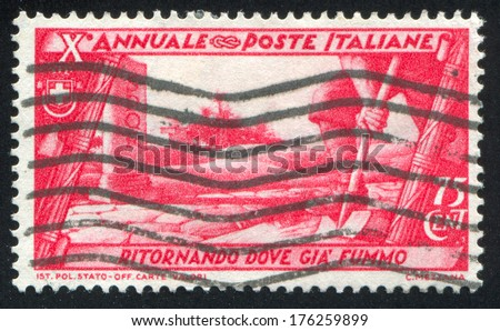 ITALY - CIRCA 1932: stamp printed by Italy, shows Excavating ruins, circa 1932 - stock photo