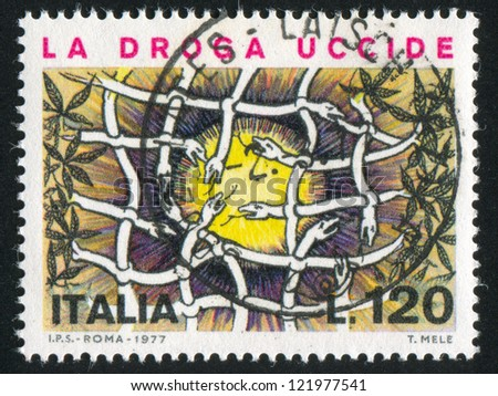 ITALY - CIRCA 1977: stamp printed by Italy, shows Snakes forming net, circa 1977