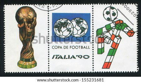 ITALY - CIRCA 1990: stamp printed by Italy, shows Symbols of World Football Championship in Italy, circa 1990 - stock photo