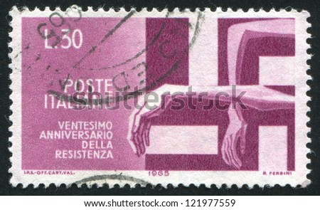 ITALY - CIRCA 1965: stamp printed by Italy, shows Victims trapped by Swastika, circa 1965
