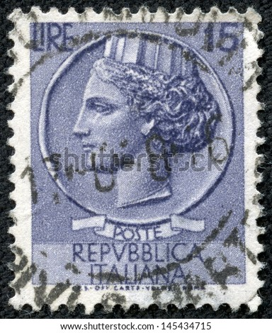 ITALY - CIRCA 1977: stamp printed in Italy shows head of a woman, who symbolize Italy after Syracusean Coin, circa 1977 - stock photo