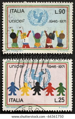 ITALY - CIRCA 1971: two stamps printed in Italy celebrates the 25th anniversary of UNICEF, the United Nations Fund providing assistance to children  in developing countries. Italy, circa 1971 - stock photo