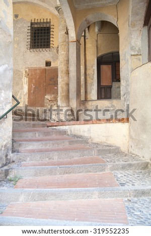 ITALY EMPIRE - JULY 14, 2014: View of the alley with stairs up to the historic center of the Empire. - stock photo