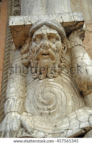 Italy Ferrara old cathedral wall  details. - stock photo