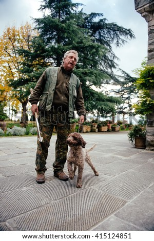 ITALY-FIRENZE- 25 october 2015 - Professional Trifulau (truffle hunter) and his dog search for truffles in the tuscanian forrest