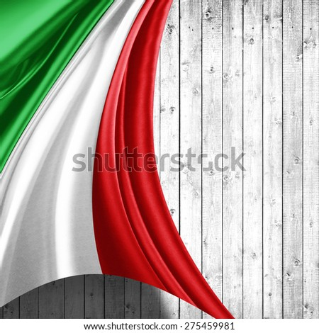 Italy flag of silk and wood background - stock photo