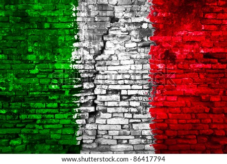 Italy flag painted on old brick wall - stock photo
