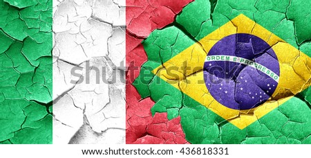 Italy flag with Brazil flag on a grunge cracked wall - stock photo