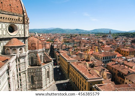 Italy. Florence. Lovely view of the Basilica di Santa Maria del Fiore, urban architecture and mountains. - stock photo