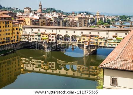Italy, Florence. View of Ponte Vecchio, the main landmark of the city - stock photo