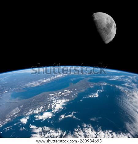Italy from space with the Moon above. Elements of this image furnished by NASA.  - stock photo