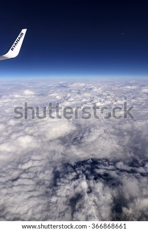 Italy; 19 January 2016, airplane flying above the clouds - EDITORIAL