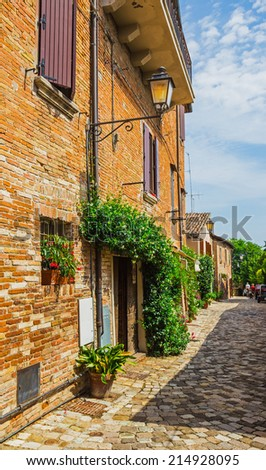 ITALY - JUNE 27, 2014: Typical Italian street in a small provincial town of Tuscan, Italy, Europe