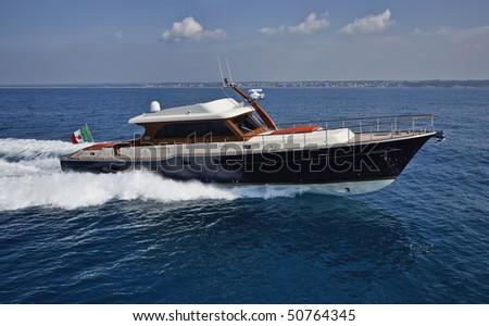 Italy, Lazio, Fiumicino, Tirrenian sea, Morgan 70' Lobster luxury yacht, aerial view - stock photo