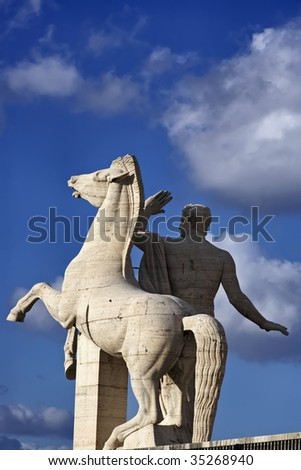 ITALY, Lazio, Rome, Eur, The horse marble statue in front of the Square Coliseum (Civilization and Work Palace) - stock photo