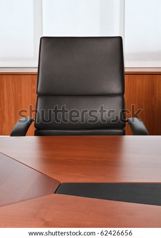 Italy, leather office chair and desk - stock photo