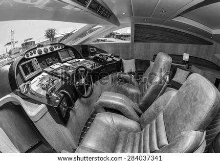 Italy, luxury yacht, dinette, driving consolle - stock photo
