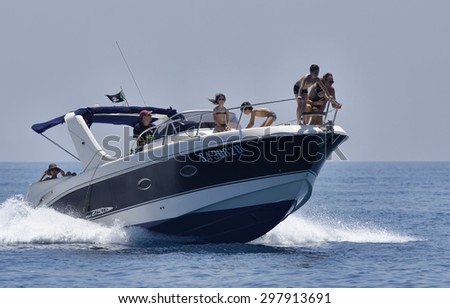 Italy, Mediterranean Sea; 18 july 2015, off the South-East sicilian coast, people cruising on a luxury yacht - EDITORIAL - stock photo