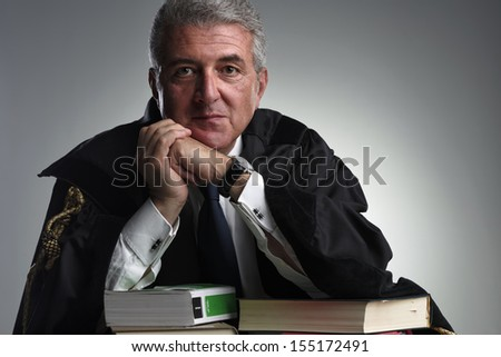 Italy, middle age lawyer studio portrait