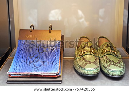 gucci bags and shoes. italy - milan november 16, 2017 boutique gucci store in brera. bags and shoes