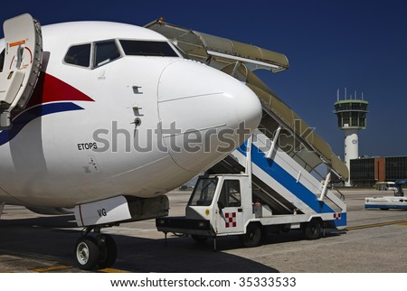 ITALY, Naples, international airport Capodichino, airplane and flight control tower - stock photo