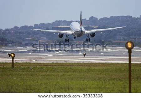 ITALY, Naples, international airport Capodichino, airplane landing and flight control lights - stock photo