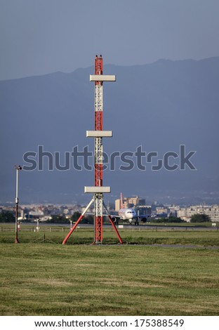 Italy, Naples International Airport, flight control sensors and airplane ready for take off - stock photo