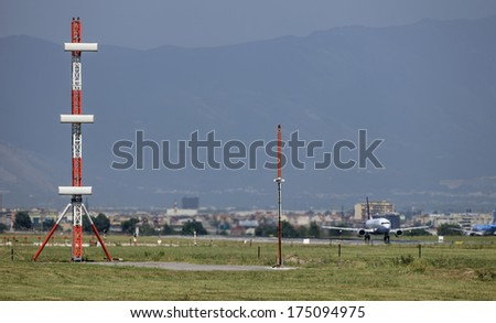 ITALY, Naples international airport, flight control sensors and airplanes ready for take off - stock photo
