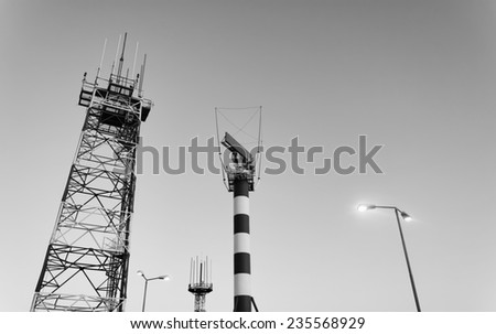 Italy, Naples International Airport, flight control sensors and radar at sunset - stock photo
