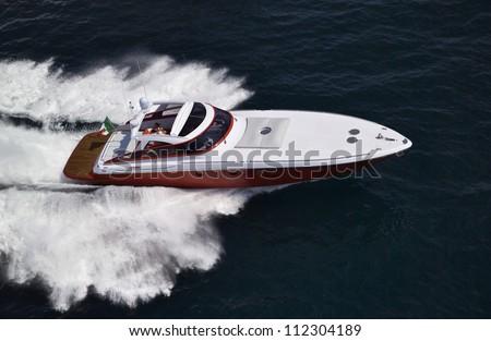 Italy, off the coast of Naples, Azzurra luxury yacht (boatyard: Cantieri di Baia), aerial view - stock photo