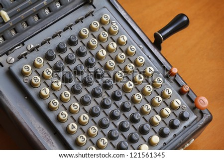 Italy, old calculator on a table - stock photo