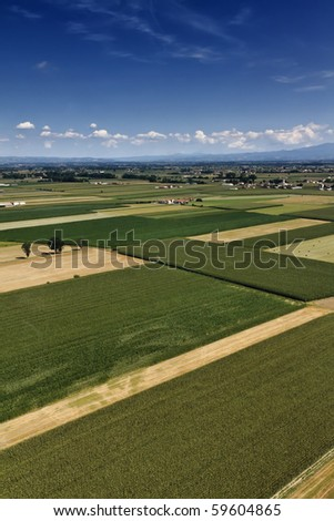 Italy, Piemonte, countryside, aerial view of farmhouses and cultivated fields - stock photo