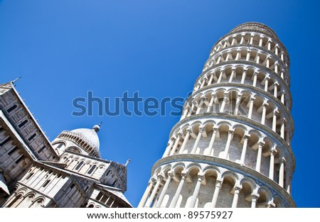 Italy - Pisa. The famous leaning tower on a perfect blue bakcground - stock photo